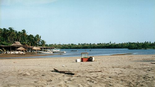 Enramada restaurants fronting the lagoon at Barra de Potosí, Guerrero, Mexico